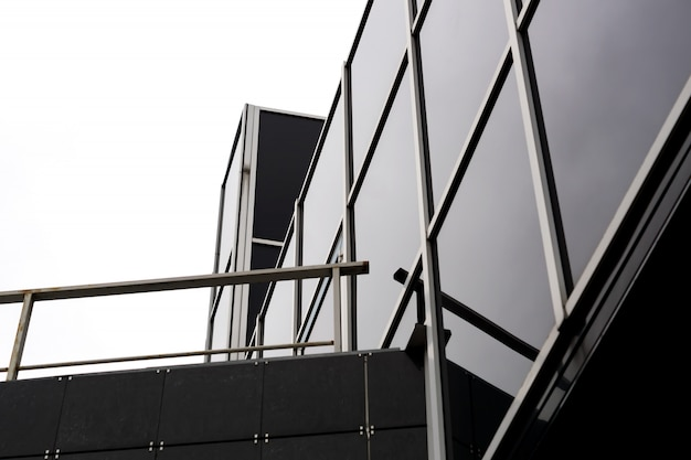 Fragment of glass and metal modern building. business office exterior.