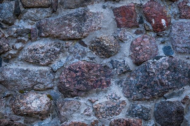 A fragment of granite masonry taken closeup in daylight