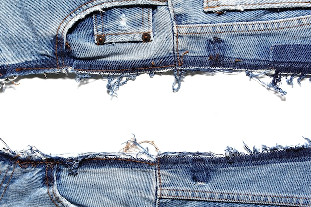 Fragment of jeans, isolated on white background