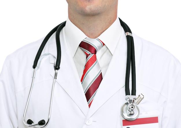 聴診器で医師のスモックを断片化します。白で隔離