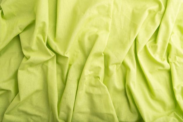 緑のリネン組織の断片。
