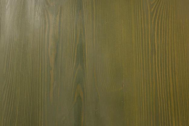 緑の木のドアの断片。クローズアップショット