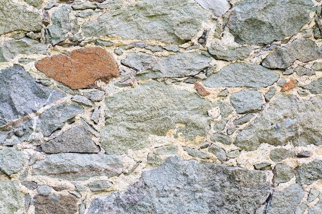 오래 된 중세 돌 벽 (배경)의 조각