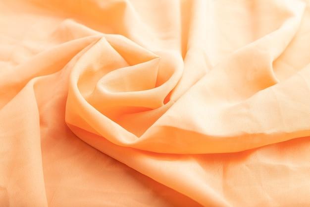 オレンジ色のリネン組織の断片