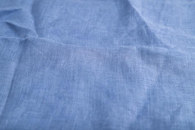 滑らかな青いリネン組織の断片。