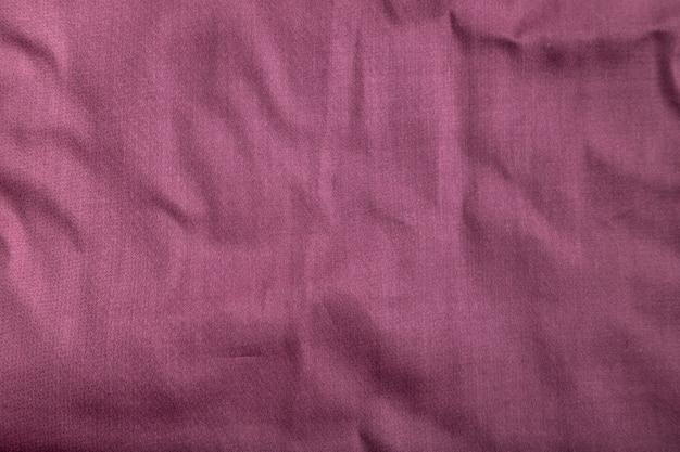 滑らかな綿紫色のティッシュの断片。