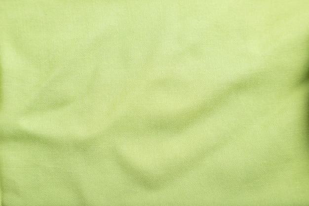 滑らかな緑色のリネン組織の断片。