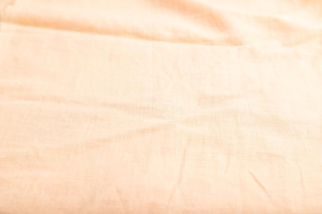 滑らかなオレンジ色のリネン組織の断片