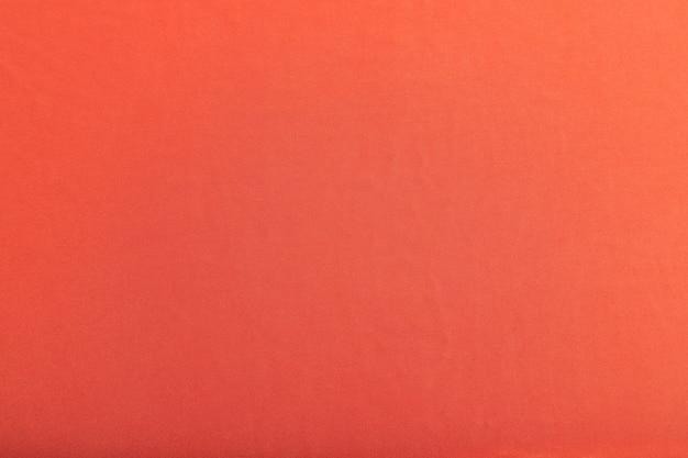 滑らかな赤い絹の組織の断片