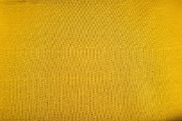 滑らかな黄色と緑色の組織の断片。
