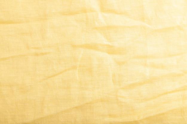 滑らかな黄色のリネン組織の断片