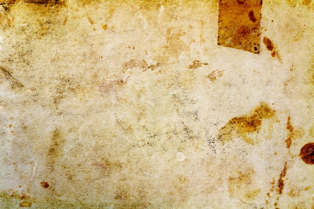 Fragment of old paper texture with dark spots. abstract background