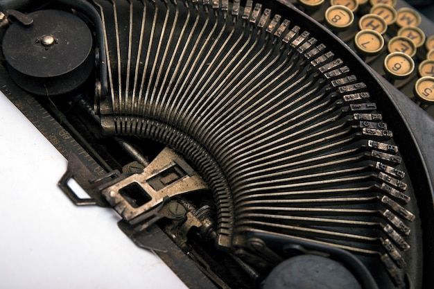 The fragment of an old and vintage typewriter. close up details of antique typewriter. vintage typewriter machine.