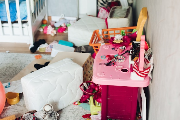 Fragment of a photo of a children's room with scattered things and toys