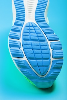 Fragment of the sole of a blue sneaker close-up