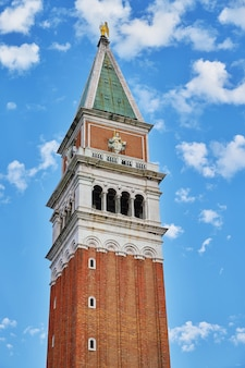 Fragment of st mark's campanile (campanile di san marco). bell tower of st mark's basilica. venice, italy