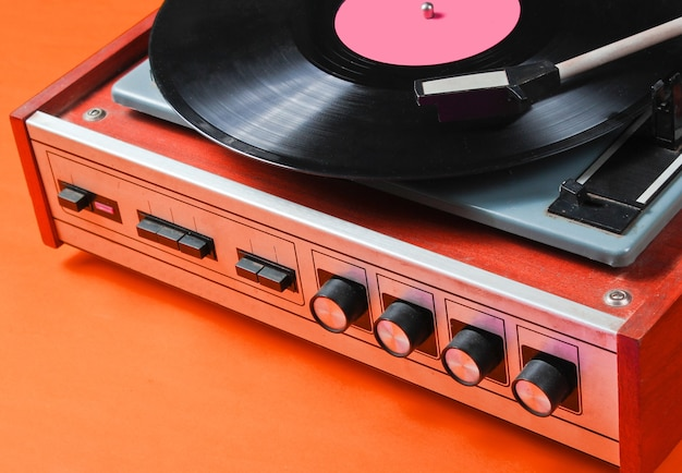 Fragment of a vinyl record player with a plate