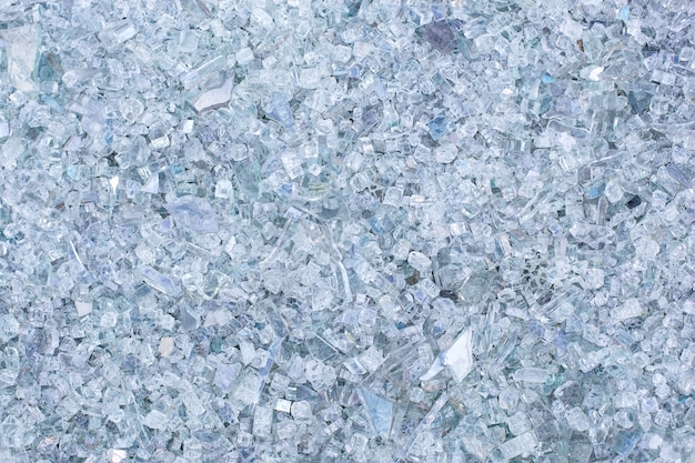 Fragments of blue glass. small and sharp fragments of broken glass. cullet for creation of new glass are ready to be remelted. lot of particles of shattered glass. garbage recycling. ecology, trash