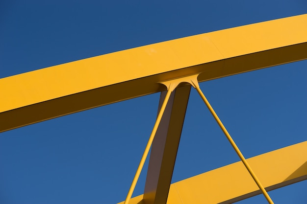Fragments of a modern yellow construction with a blue
