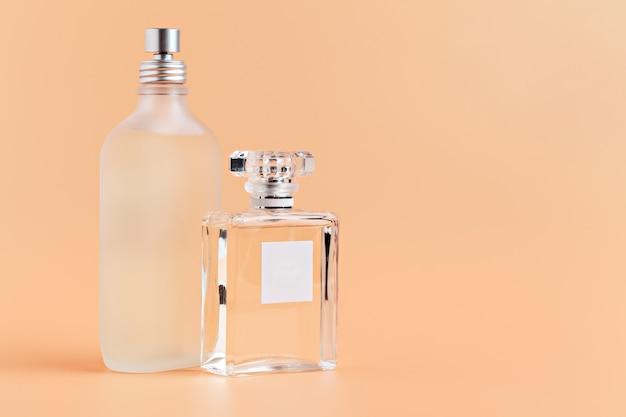 Fragrance bottles close up on a light beige