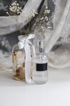 Fragrance spray in transparent plastic bottle with black empty tag