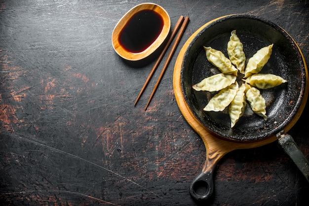 Fragrant chinese gedza dumplings with meat. on dark rustic