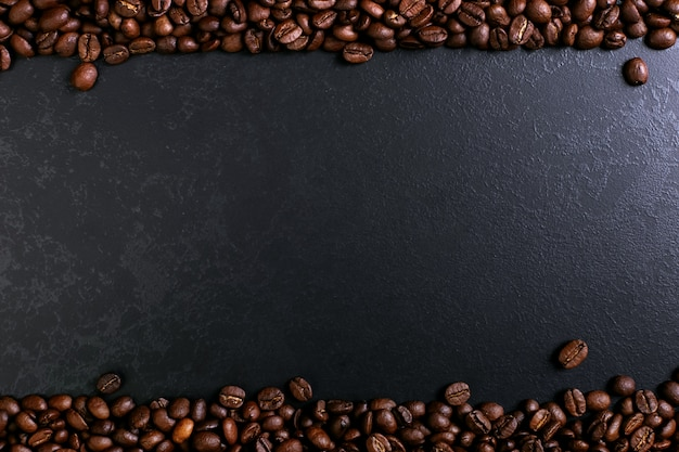 Fragrant coffee beans on rustic tabletop background