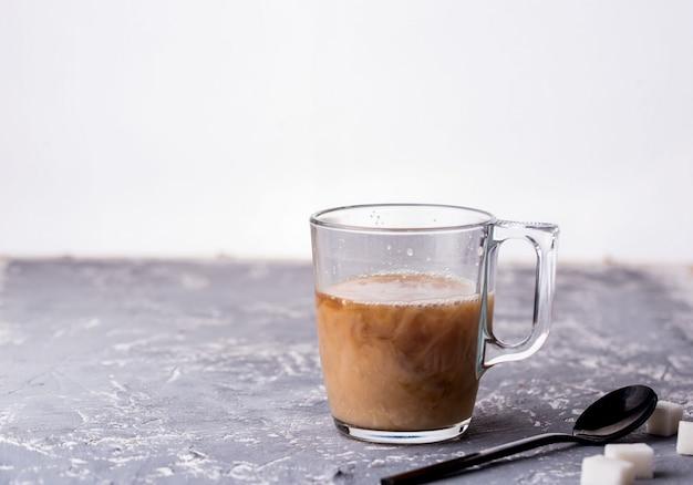 Fragrant custard with milk, spoon, sugar, concrete background. Premium Photo