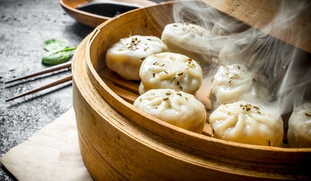 Fragrant hot dumplings of manta. on rustic surface