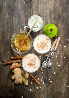 Fragrant smoothie of pear , ginger, cinnamon and honey. on rustic background.