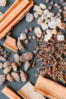 Fragrant spices on a dark table