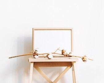 Frame and elegant branch on stool