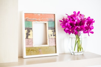 Frame and flower pot with flowers