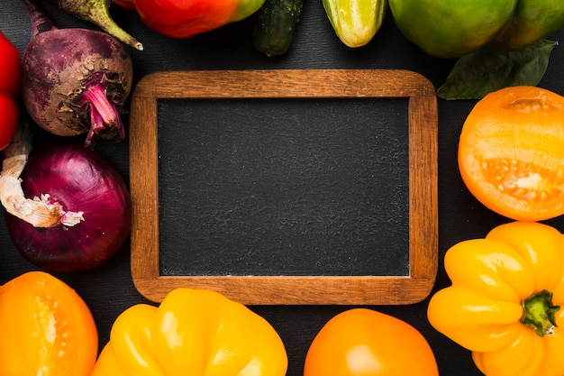 Frame arrangement made of vegetables on dark background