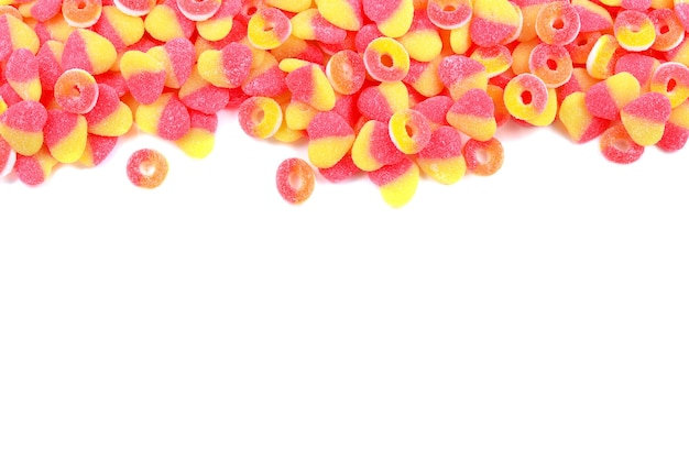 Frame of assorted gummy candies isolated on white top view space for text or design