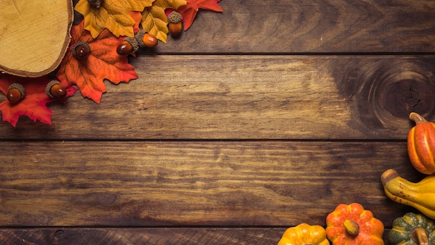 Frame of autumn leaves and pumpkins