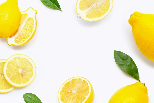 Frame background made of fresh lemon with slices and leaves isolated