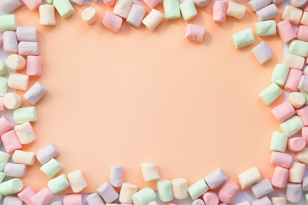 Frame background made of marshmallows . the concept of childhood