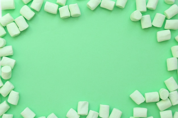 Frame background made of marshmallows . the concept of childhood.