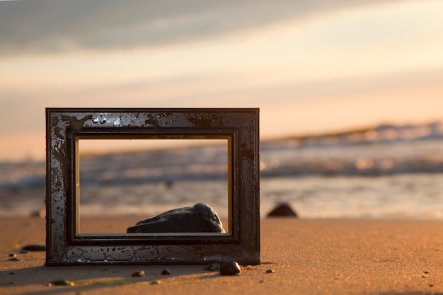 Frame in a beach