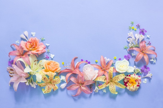 Frame of beautiful garden flowers on paper background