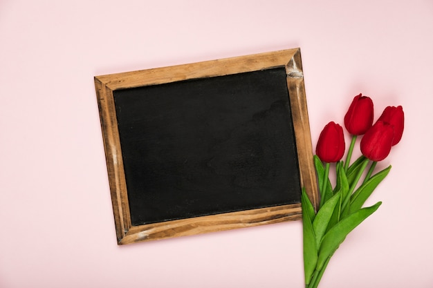 Frame beside bouquet of tulips