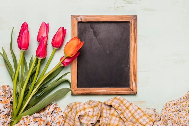 Frame blackboard with bouquet of tulips
