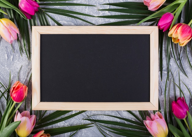 Frame blackboard with flowers along edges