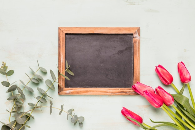 Frame blackboard with flowers