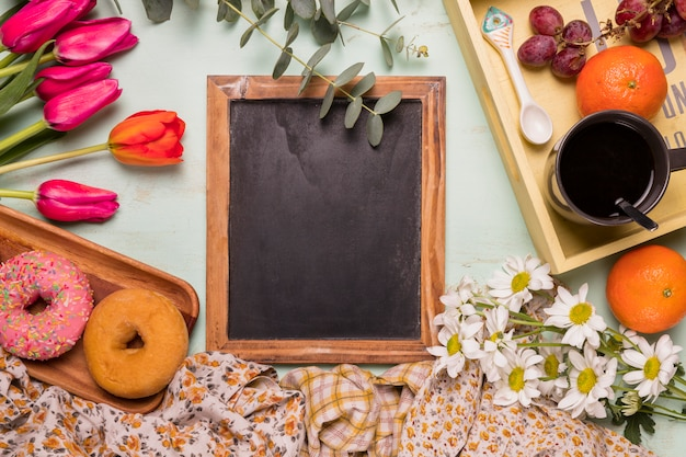 Frame chalkboard with sweet arrangement of breakfast