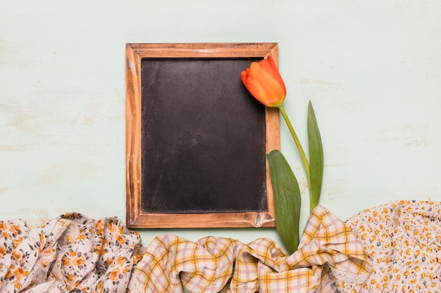 Frame chalkboard with tulip and shawls