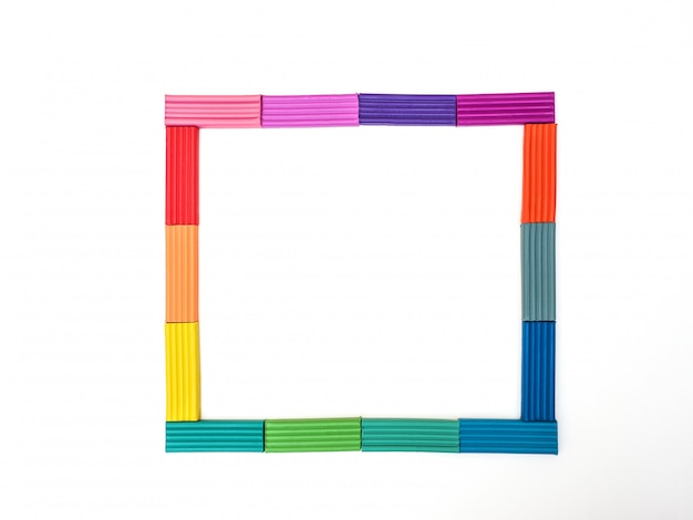 Frame of colored plasticine on isolated white background