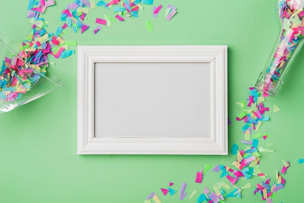 Frame and confetti with green background