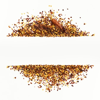 Frame of crushed red cayenne pepper, dried chili flakes and seeds isolated on a white
